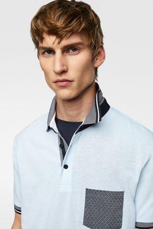Poloshirt med lomme i kontrast