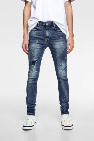 Zara Hullede jeans med læg