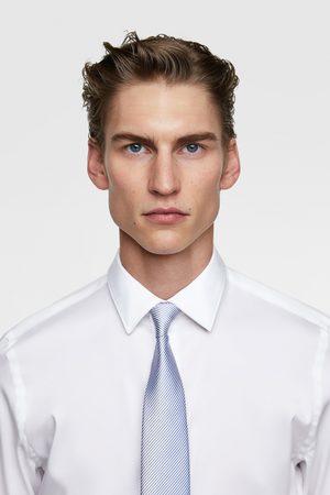 Zara Bredt, tofarvet slips