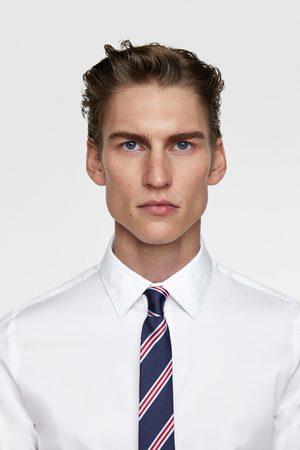 Zara Smalt slips med striber