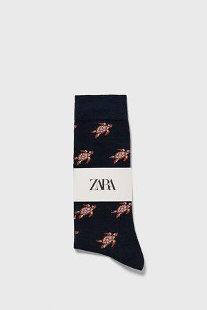 Zara Jacquardvævede strømper med skildpaddemotiv