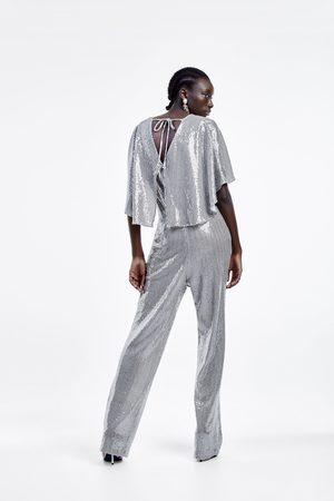 Zara Skinnende buksedragt med kappeærmer