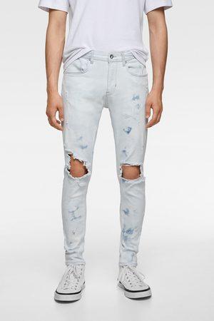 Zara Skinny jeans med huller og malerpletter