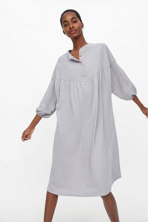 Zara Kjole med bluselook med knapper