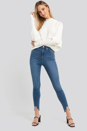 NA-KD Super High Waist Asymmetrical Hem Jeans