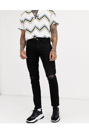 ASOS Sorte skinny jeans med hullede knæ fra