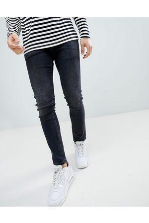 River Island Forvaskede sorte skinny jeans fra