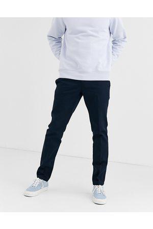 Dickies 872 – mørk marineblå bukser til jobbet med smal pasform