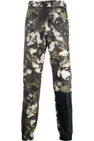 MARCELO BURLON Bukser med kamuflagetryk og løbesnor