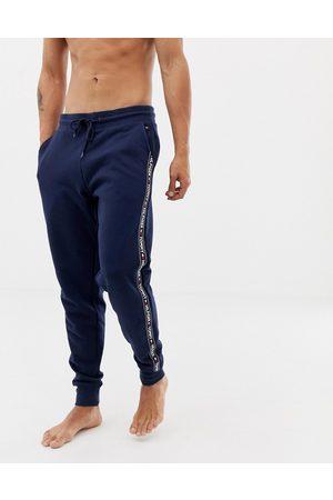Tommy Hilfiger Marineblå joggingbukser med manchet og logobånd fra Authentic