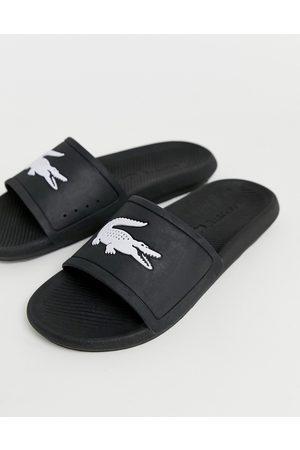 Lacoste Sorte kroko-badesandaler