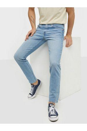 Levi's Levis 512 Slim Taper Manilla Bean Ad Jeans Indigo