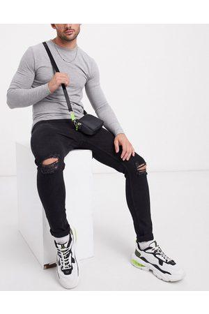 Bershka Sorte super skinny-jeans med flænsede knæ
