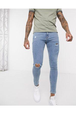 ASOS Spray-on jeans i strækbar denim i let vask med huller