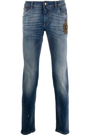Dolce & Gabbana Mænd Slim - Jeans med smal pasform og perledekoreret krone