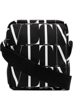 VALENTINO GARAVANI Black VLTN nylon logo print camera bag