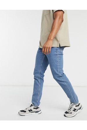 ASOS Slim-jeans med stræk i flad mid wash