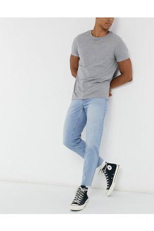 ASOS Klassiske jeans uden stræk i light blue wash med rå kant
