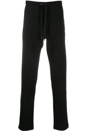 Dolce & Gabbana DG Crest print track pants