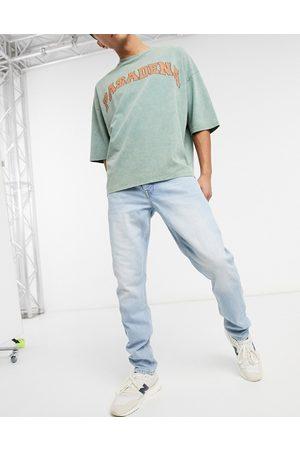ASOS Smalle jeans i bleget retrovask