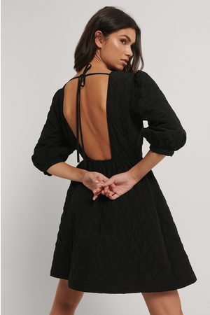 NA-KD Quilted Open Back Mini Dress