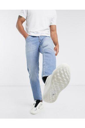 ASOS Tapered jeans med stræk i vintage light wash blå