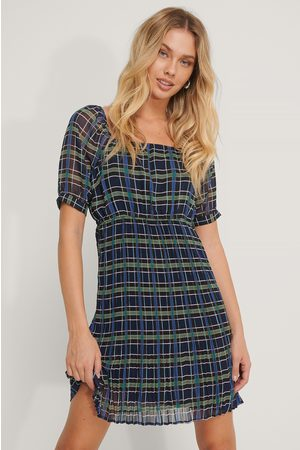 NA-KD Pleated Skirt Uniform Dress
