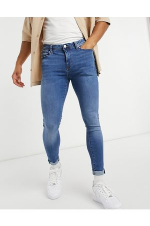 River Island Tætsiddende skinny jeans i mellemblå vask