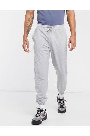 ASOS Mænd Joggingbukser - ASOS - 4505 icon - Gråmelerede joggingbukser til træning i tapered pasform
