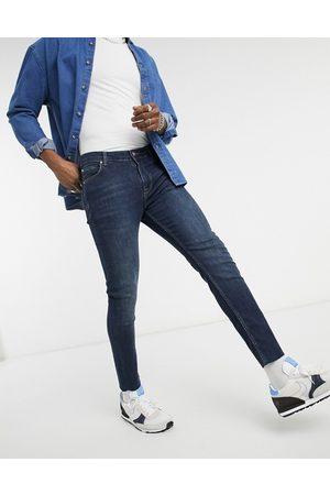 ASOS DESIGN Skinny-jeans i vintage mørk vask med rå søm-Blå