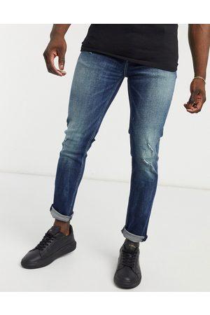 ASOS Mørkeblå skinny jeans med slidt finish i vintage-inspireret, japansk vask
