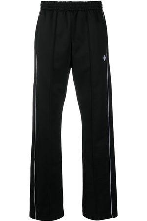 MARCELO BURLON Cross loose track pants