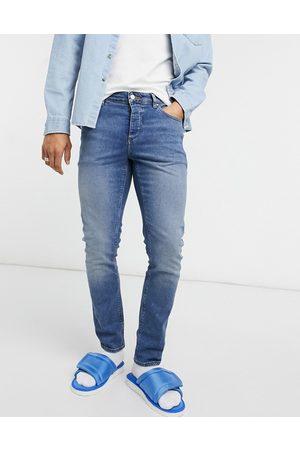 ASOS Slim-jeans med stræk i vintage mid wash blå