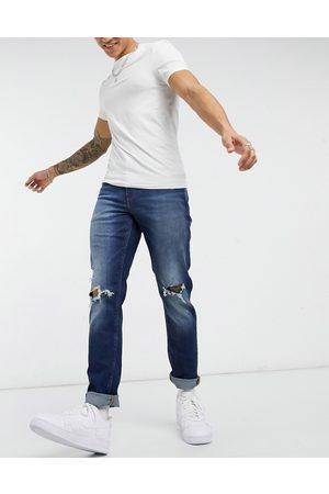ASOS Mørkvaskede slimfit-jeans i stræk og hullede knæ fra