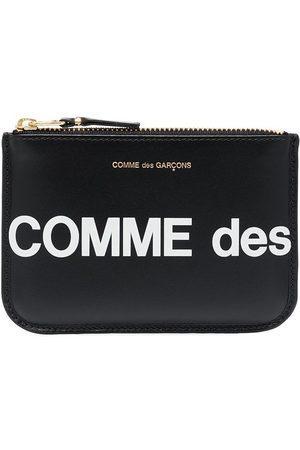 Comme des Garçons Kvinder Clutches - Pouch-taske med logotryk og lynlås