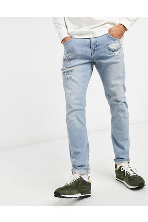 ASOS Slim-jeans med stretch, flænger og sliddetaljer i lyseblå vask