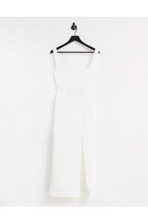 True Violet Eksklusive produkter - midaxi-kjole i bodycon-form med firkantet hals og lårslids-Creme
