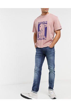 Jack & Jones Intelligence - Glenn - Super-strækbare tapered jeans i darkwash blue