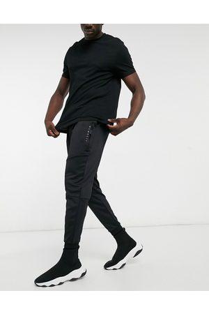 ASOS Tapered joggingbukser i , svampet stof med romertal