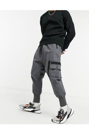 ASOS DESIGN Posede bukser med MA1 lomme og buksekanter i jersey