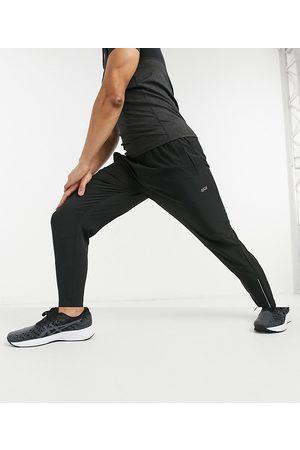 ASOS Tapered løbe-joggingbukser i Skinny Fit med reflekterende lynlås-detalje