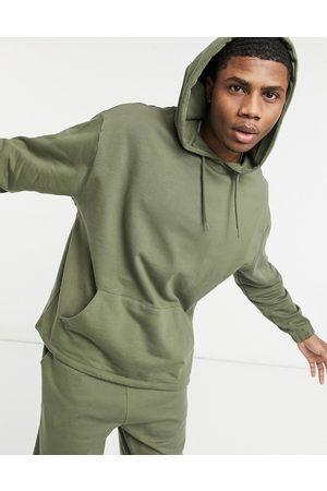 ASOS Kakifarvet træningssæt i økologisk bomuld med oversized hættetrøje og oversized joggingbukser-Grøn