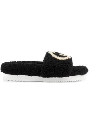 Gucci Interlocking G shearling slides
