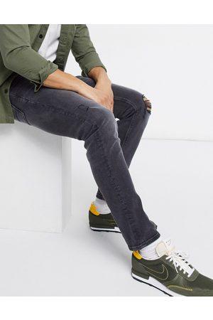 ASOS Slim-jeans med stretch, flænger på knæene og sliddetaljer i vasket