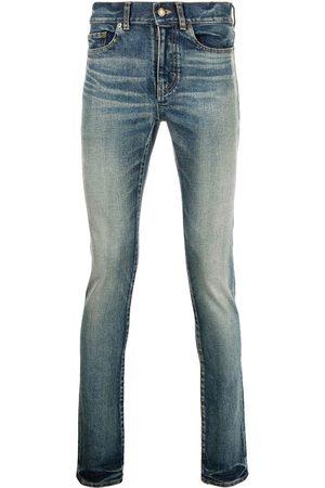 Saint Laurent Jeans med smal pasform og whiskering-effekt