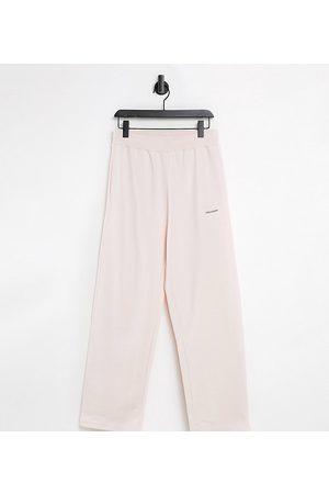 COLLUSION Unisex afslappede joggingbukser med høj talje i lyserød - Del af sæt