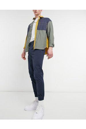 Jack & Jones Intelligence - Marineblå bukser med tætsiddende buksekanter