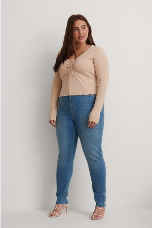 NA-KD Økologiske Skinny Højtaljede Jeans Med Rå Hem