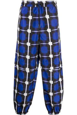 MARCELO BURLON Shorts med ternet tryk