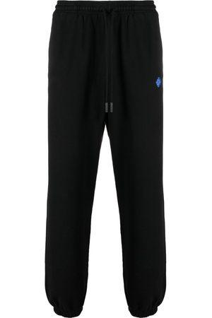 MARCELO BURLON Cropped bukser med geometrisk tryk